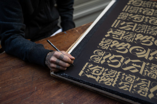 the-divine-letter-gold-on-black-edition-cryptik-print-them-all-lithograph-signature-detail-artprint